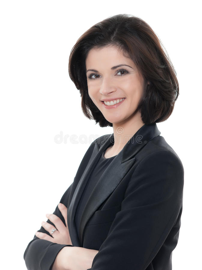 Den härliga le caucasian affärskvinnaståenden beväpnar korsat royaltyfri foto