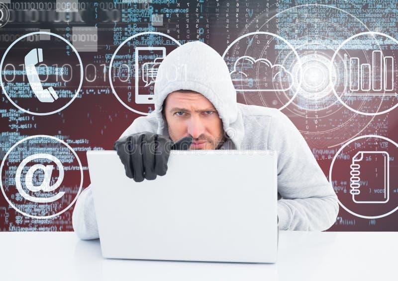 En hacker med handskar genom att använda en bärbar dator framme av digital bakgrund arkivbild