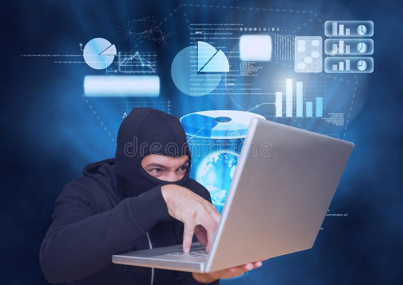En hacker med huven som framme arbetar på en bärbar dator av blå digital bakgrund royaltyfri foto