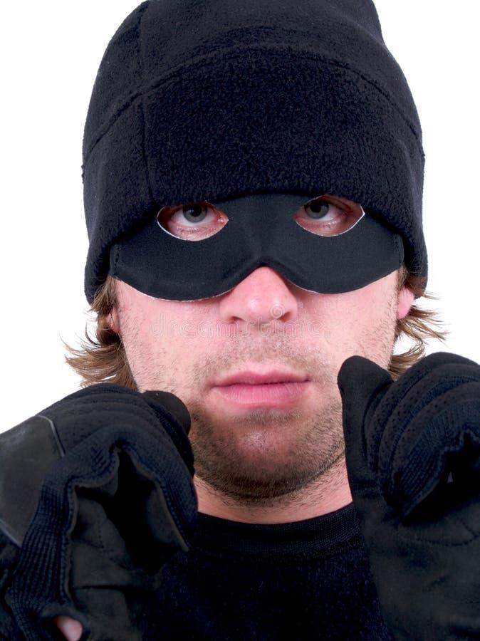 En handfängslad maskerad brottsling royaltyfri fotografi