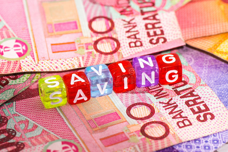 En handinnehavkrus av pengar arkivfoto