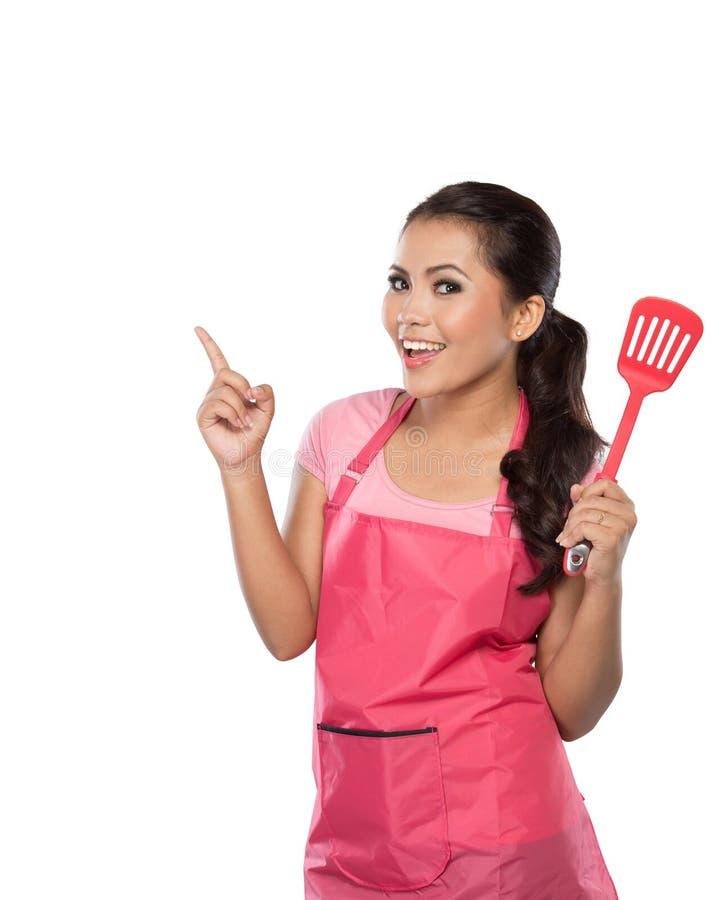 En huisvrouw of chef-kok die tonen voorstellen stock fotografie
