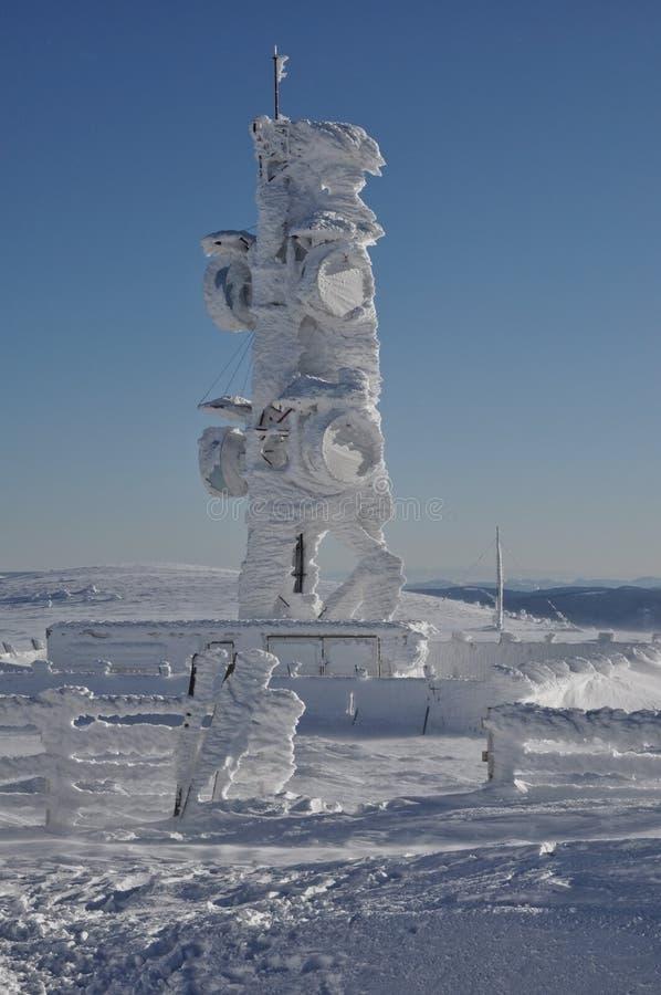 En ice-covered meteorological station royaltyfria bilder