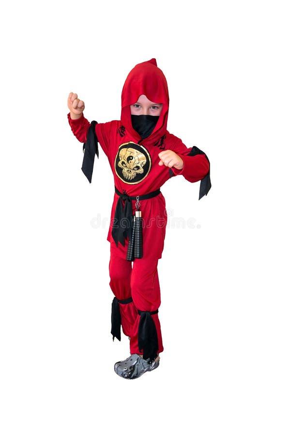 En iklädd röd ninjadräkt för barn royaltyfri fotografi