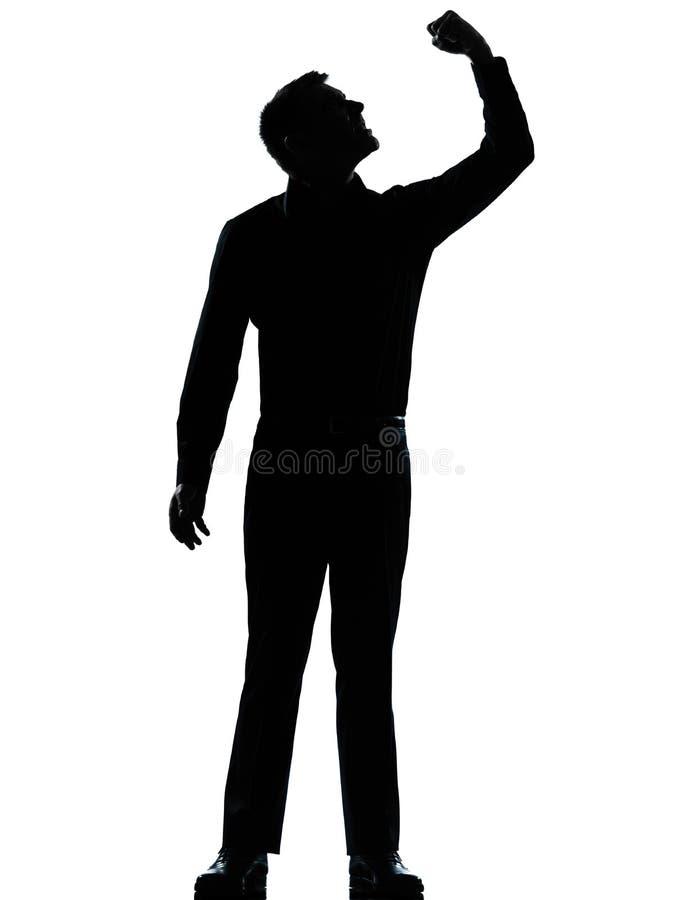 En ilsken fisting för affärsman upp silhouette royaltyfria bilder