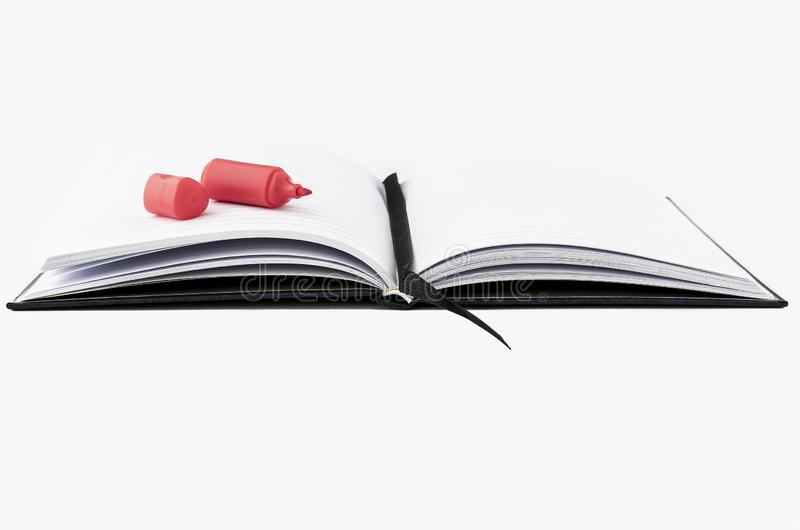 En isolerad anmärkningsbok på en vit bakgrund arkivbild