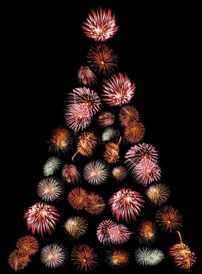 En julgran som göras av fyrverkerier arkivfoton