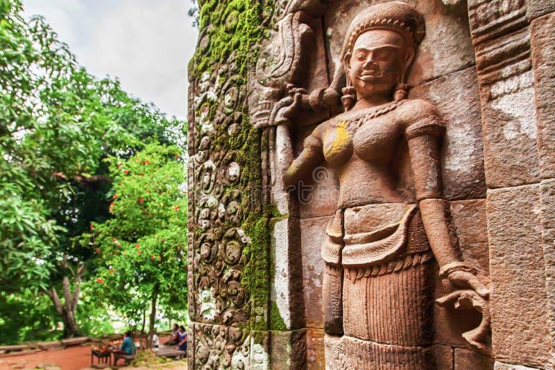 En Khmer Apsaras gamla staty arkivfoto