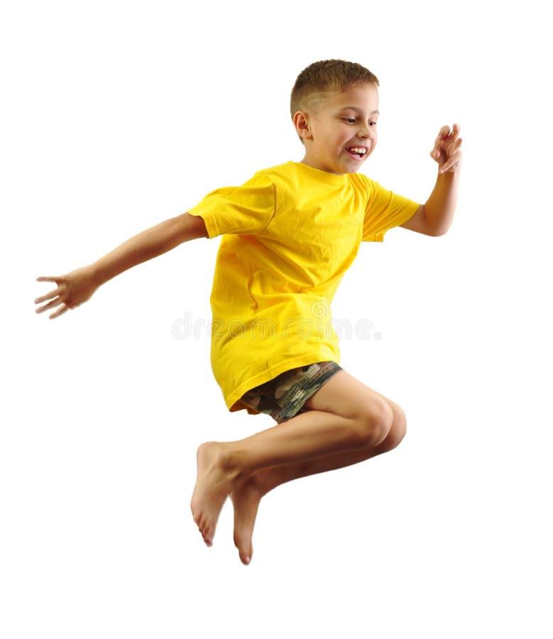 En kind die uitoefenen springen royalty-vrije stock fotografie