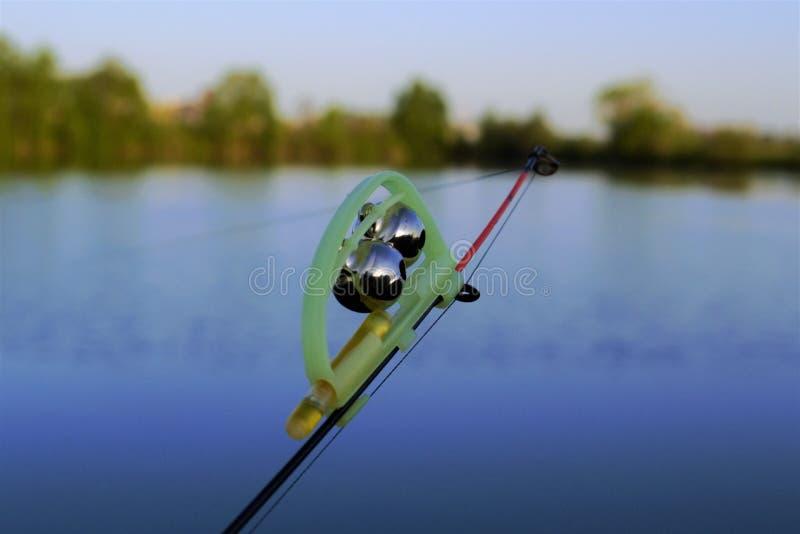 En klocka på en fiskepol royaltyfri foto