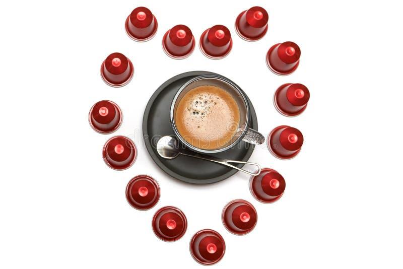 En kopp av espressokaffekapslar arkivbild