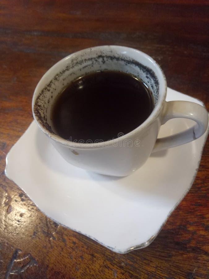 En kopp av troget svart kaffe arkivfoton