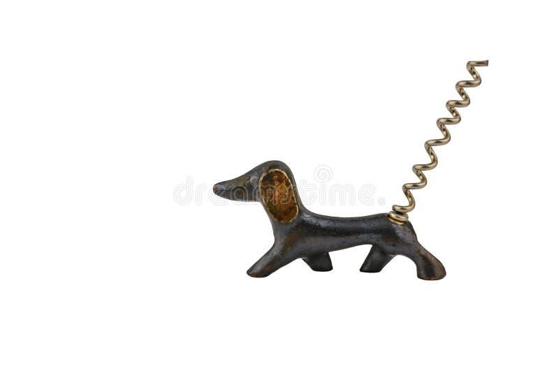 En korkskruv för vinhunden med en svans på vit bakgrund royaltyfri fotografi