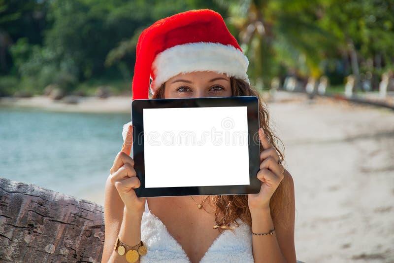 En kvinna i en julhatt fotografering för bildbyråer