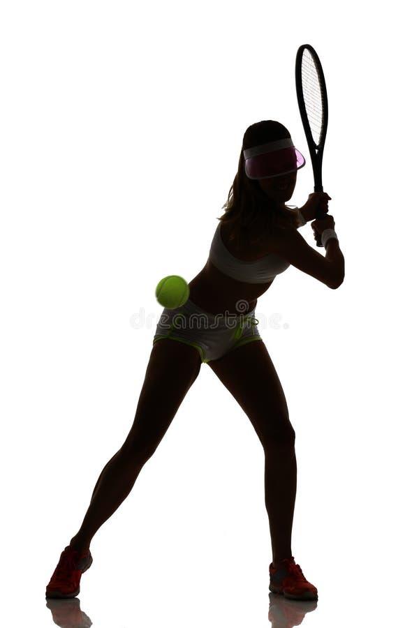 En kvinnatennisspelare i den isolerade studiokonturn royaltyfria foton
