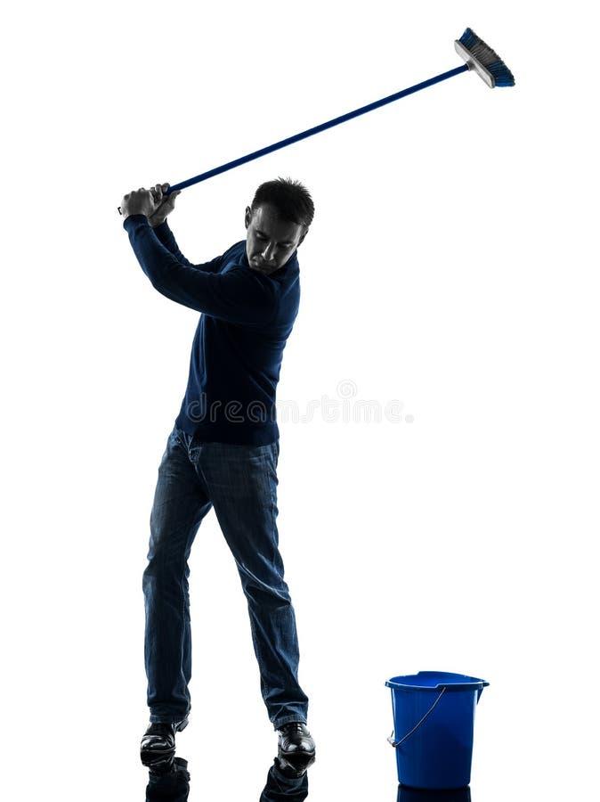 Bemanna den sopa för mer ren fulla längden golfspelsilhouette för dörrvakt arkivfoton