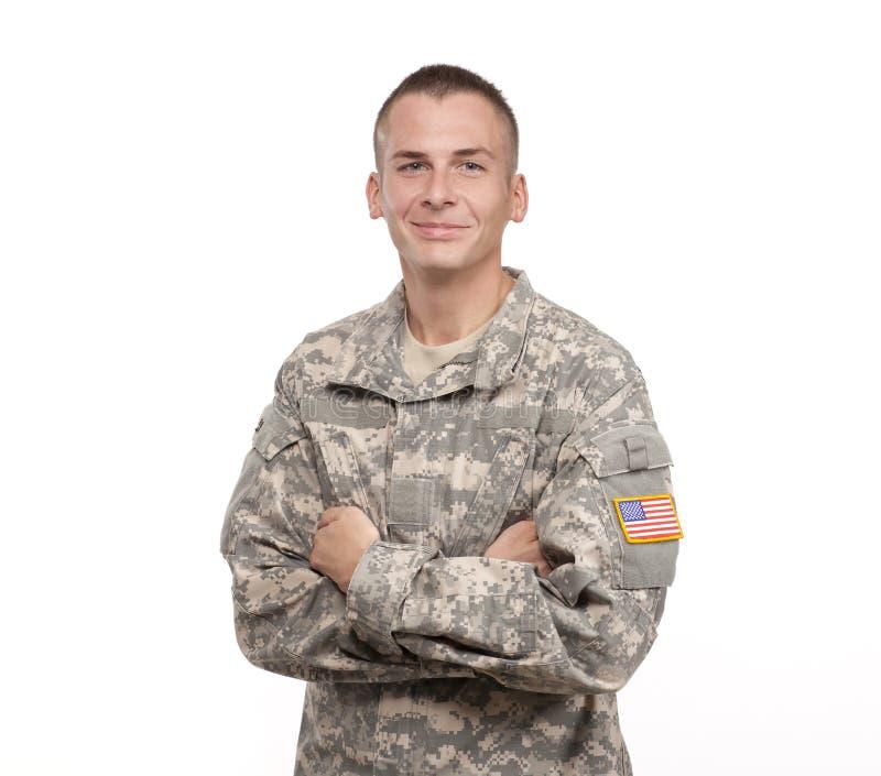 Lycklig soldat på vitbakgrund royaltyfria foton