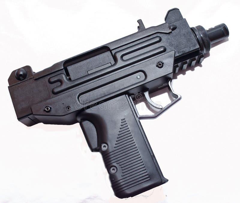 En liten svart pistol med en vit bakgrund arkivfoton