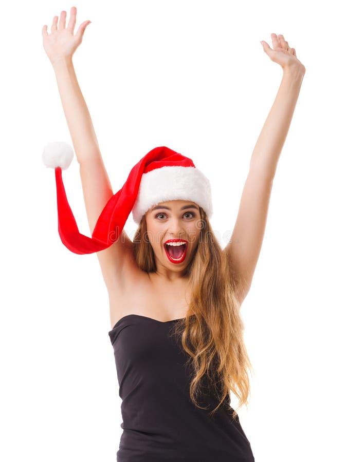 En lycklig flicka i en röd hatt och i en svart klänning ler i huvudsak isolerat arkivbilder