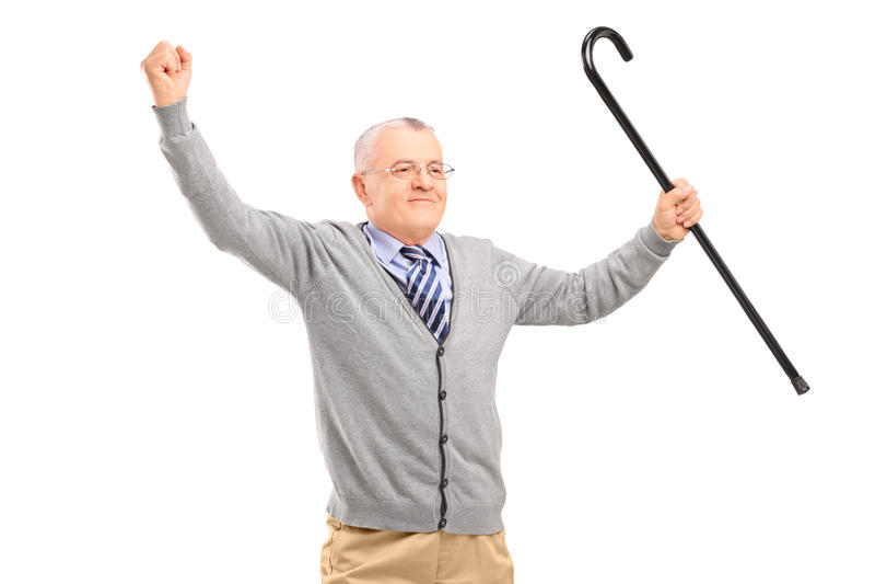 En lycklig hög man som rymmer en rotting och gör en gest lycka royaltyfria foton