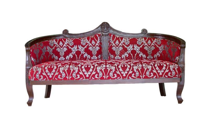 En lyxig röd soffa på en vit bakgrund med banan fodrar fotografering för bildbyråer