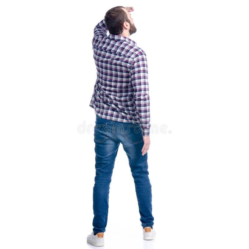 En man i jeans och skjortablickar in i avståndet arkivbilder
