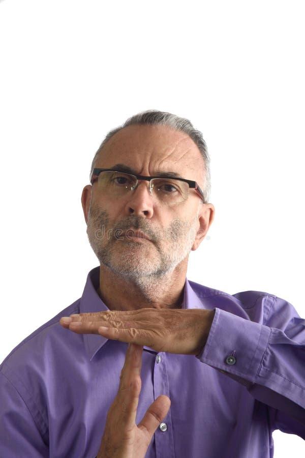 En man med danandetid ut gör en gest royaltyfri fotografi