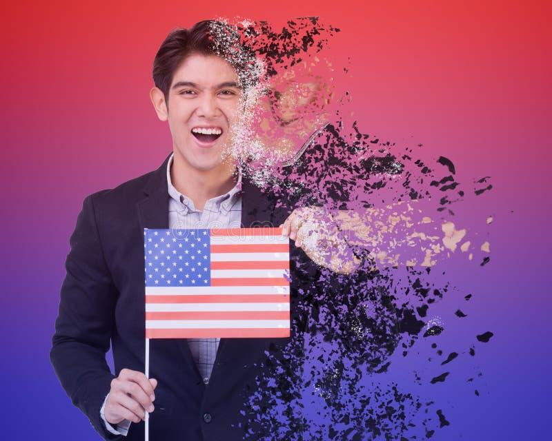 En man rymmer USA flaggan med spridningeffekt arkivbilder