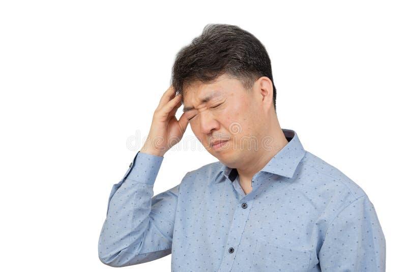 En medelålders man som lider från huvudvärk på vit bakgrund royaltyfria bilder
