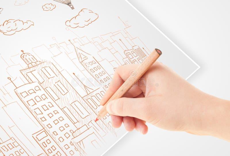 En personteckning skissar av en stad med ballonger och moln på a royaltyfria bilder
