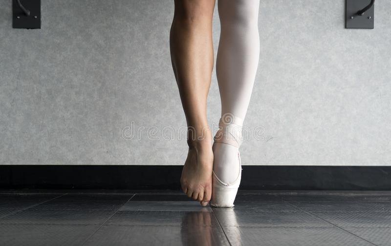 En pointe and the behind the scenes of a ballet dancer`s hard work and training stock photography