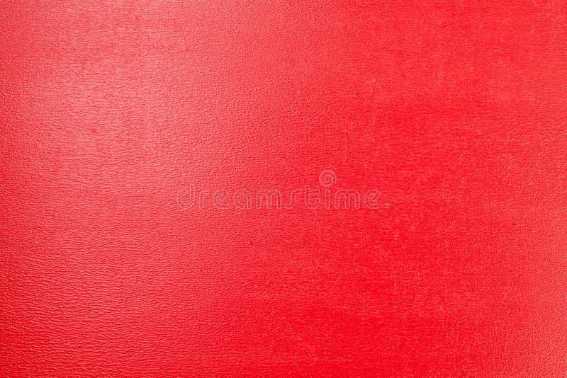 En röd glansig bakgrund med arkivbild