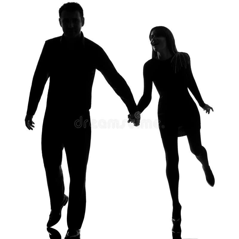 En running hand för för parman och kvinna - in - hand royaltyfri bild
