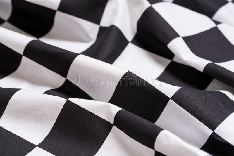 En rutig flaggabakgrund - motoriskt springa - symbol för att segra arkivfoton