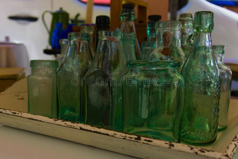 En samling av glasflaskor royaltyfria bilder