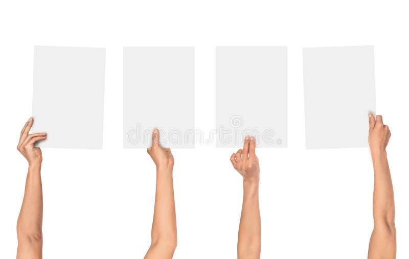 En samling av kvinnliga händer som rymmer papper arkivbild