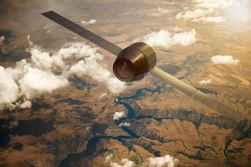 En satellit som kretsar kring jorden arkivbilder