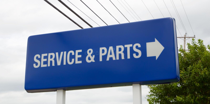 En service för bilåterförsäljare och ett deltecken royaltyfri fotografi