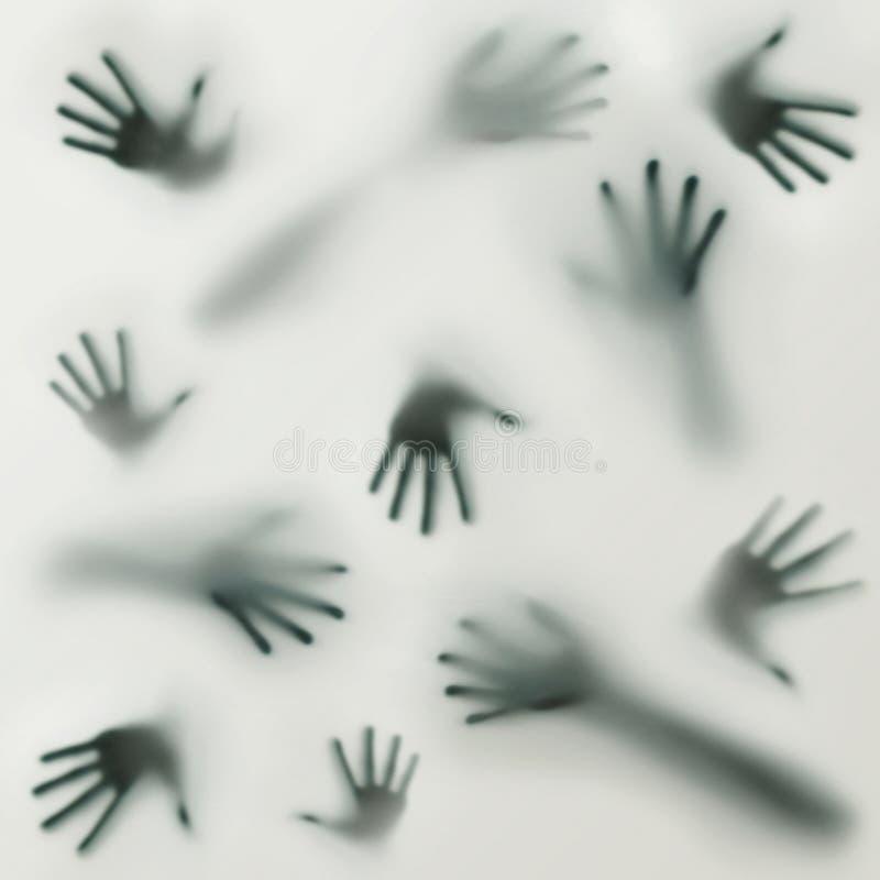 En skrämma silhouette av många olika räcker fotografering för bildbyråer