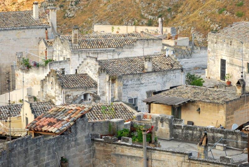 En skymt av en liten by av staden av Matera i Basilicata royaltyfria bilder