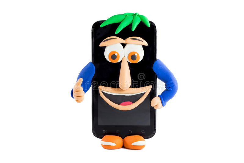 En Smartphone med en lycklig framsida som göras i plasticine royaltyfri foto