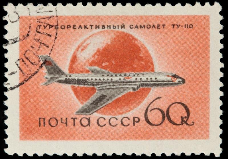 En stämpel som skrivs ut i USSR, visar flygplanet Tu royaltyfria foton