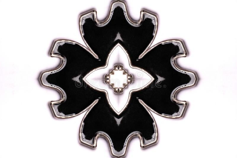 En symmetriskt formad hänge för blomma kronblad royaltyfri foto