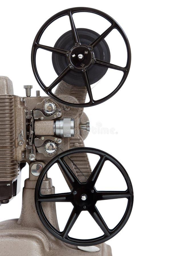En tappningfilmprojektor på en vitbakgrund arkivfoton