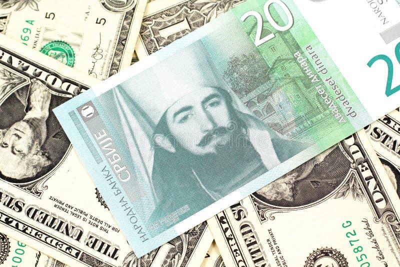 En tjugo serbisk dinar med amerikanen en dollar räkningar royaltyfri fotografi