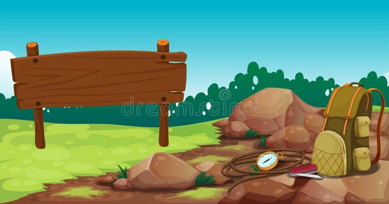 En tom träskylt nära vaggar med en påse stock illustrationer