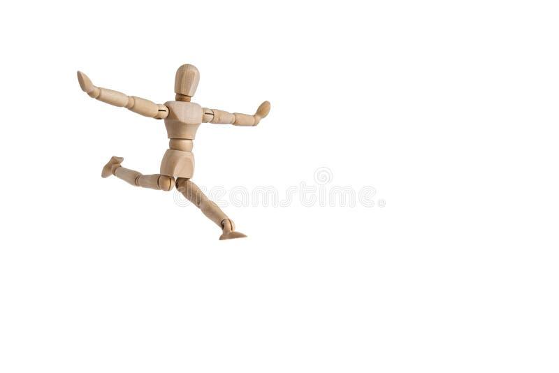 En trädockaman utför en dans och en böjlighet royaltyfria bilder