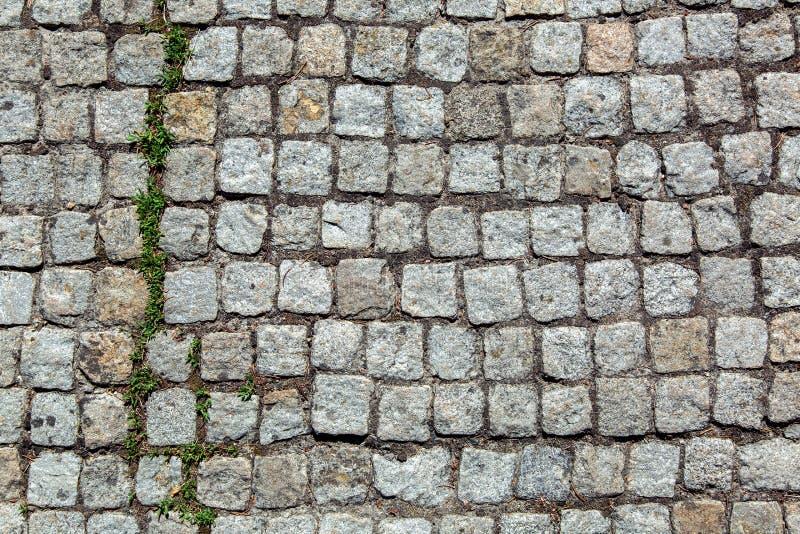 En trottoar som göras av granitstenen royaltyfri foto
