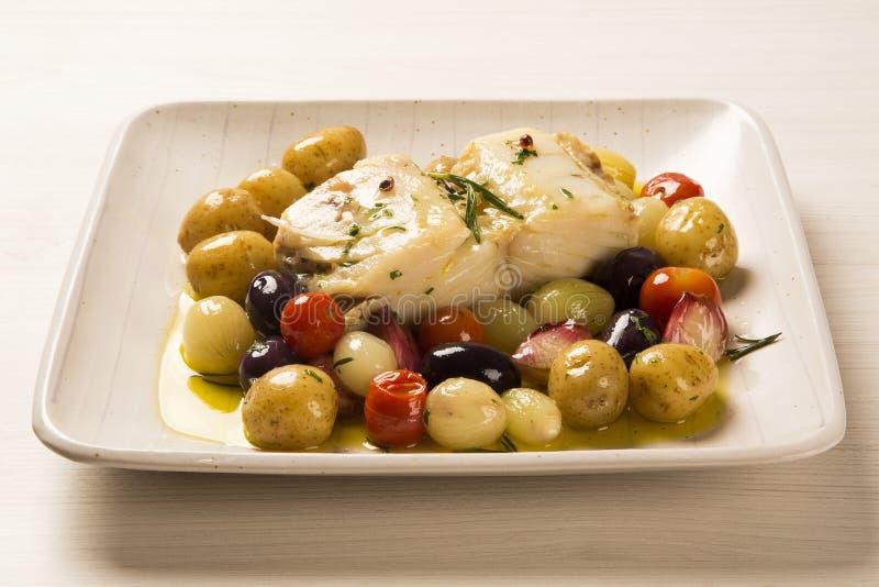 En typisk portugisisk maträtt med codfish kallade Bacalhau gör Porto arkivbilder