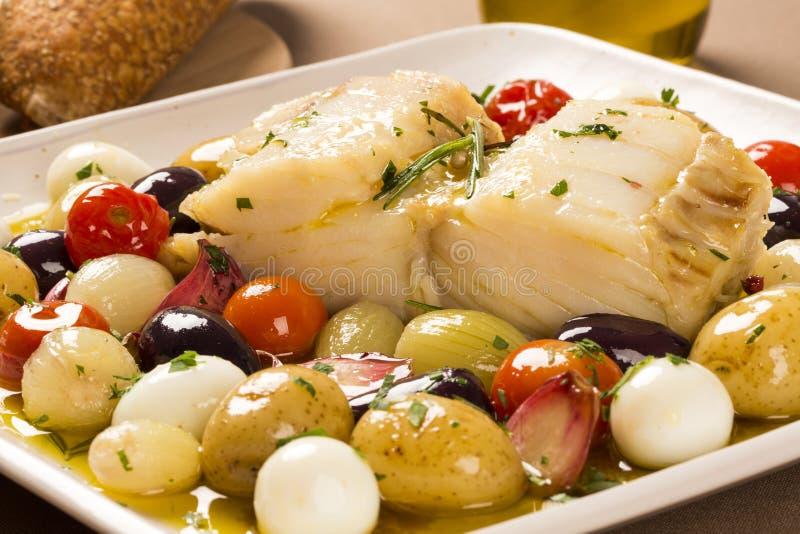 En typisk portugisisk maträtt med codfish kallade Bacalhau gör Porto royaltyfri foto